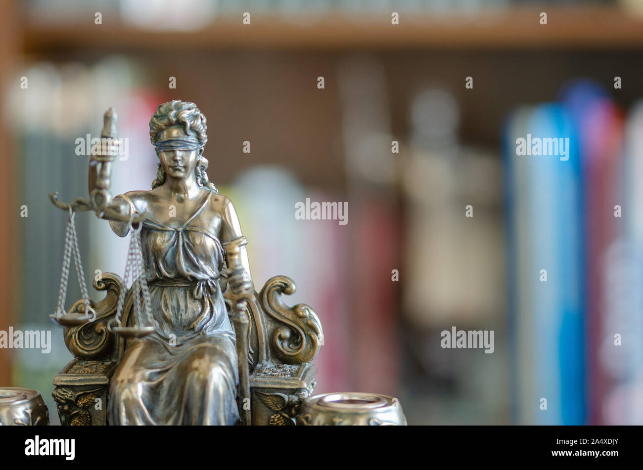 Statue of justice in front of library, law concept. Stock Photo