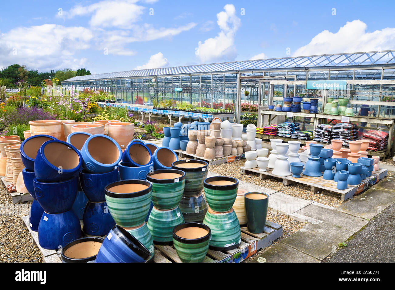 A variety of ceramic and terracotta plant pots stacked at a garden nursery, UK Stock Photo