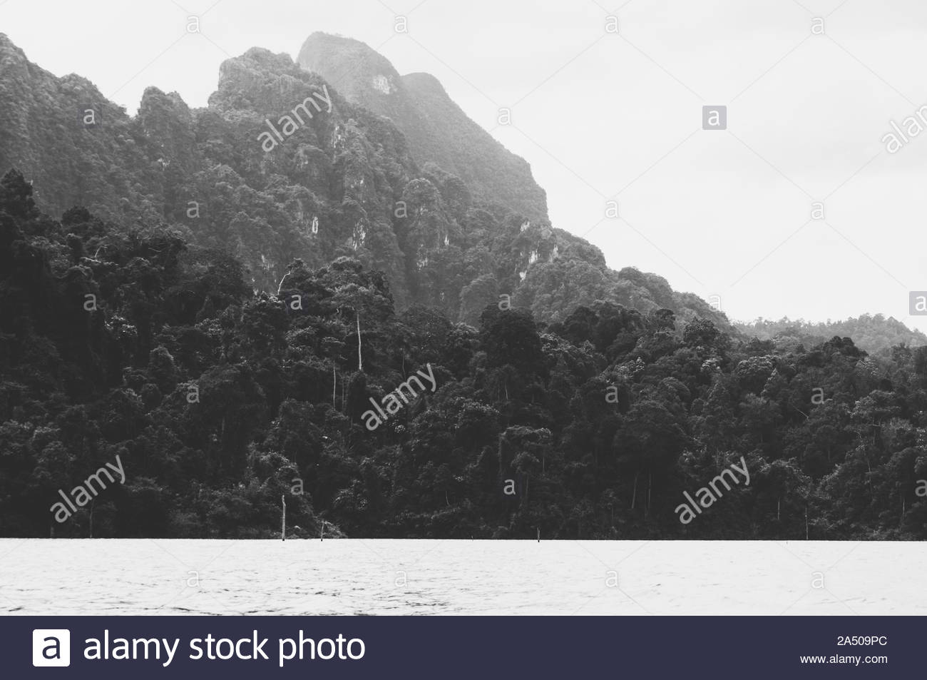 Mountains lake river sky and natural attractions in  Ratchaprapha Dam at Khao Sok National Park - location for Recall deutschland sucht den superstar Stock Photo