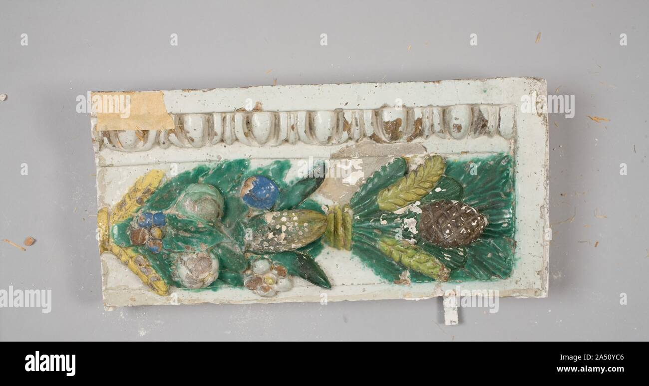 Fragment, c. 1900-1910. In this work, originally forming an altarpiece, the graceful figures are coloured with vitreous glazes, essentially a substitute for the more costly carved marble. The two shields below bear the arms of the Borgherini Family, and probably graced a chapel in Florence owned or endowed by this family. The artist, Benedetto Buglioni, was a sculptor of stature in early sixteenth century Florence. He learned the technique of glazed terracotta sculpture from the Della Robbia Family, examples of whose work may be seen nearby in this gallery. Stock Photo