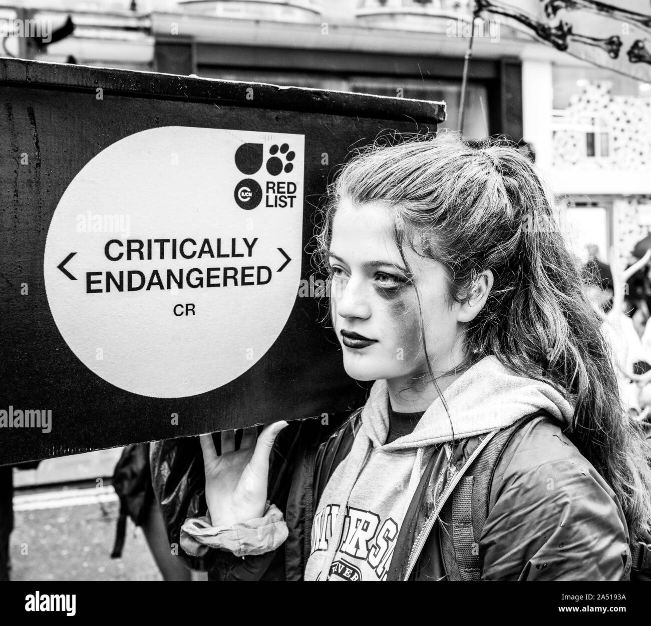 Extinction Rebellion youth Protester carries coffin for endangered species - London October 2019 Stock Photo