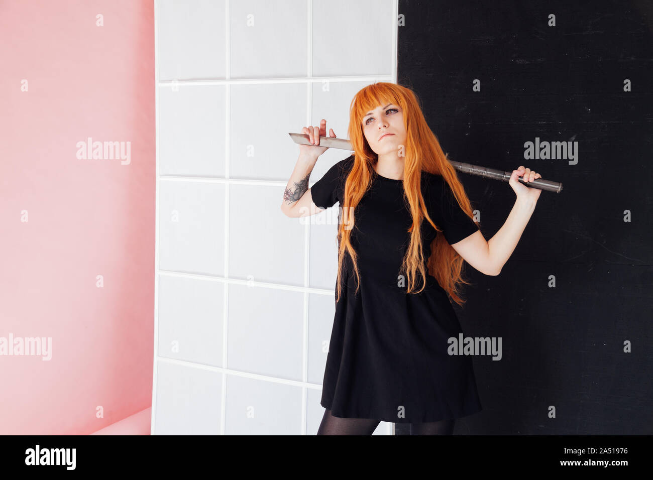 Woman Cosplayer Anime With Red Hair Holds A Japanese Sword Stock Photo Alamy