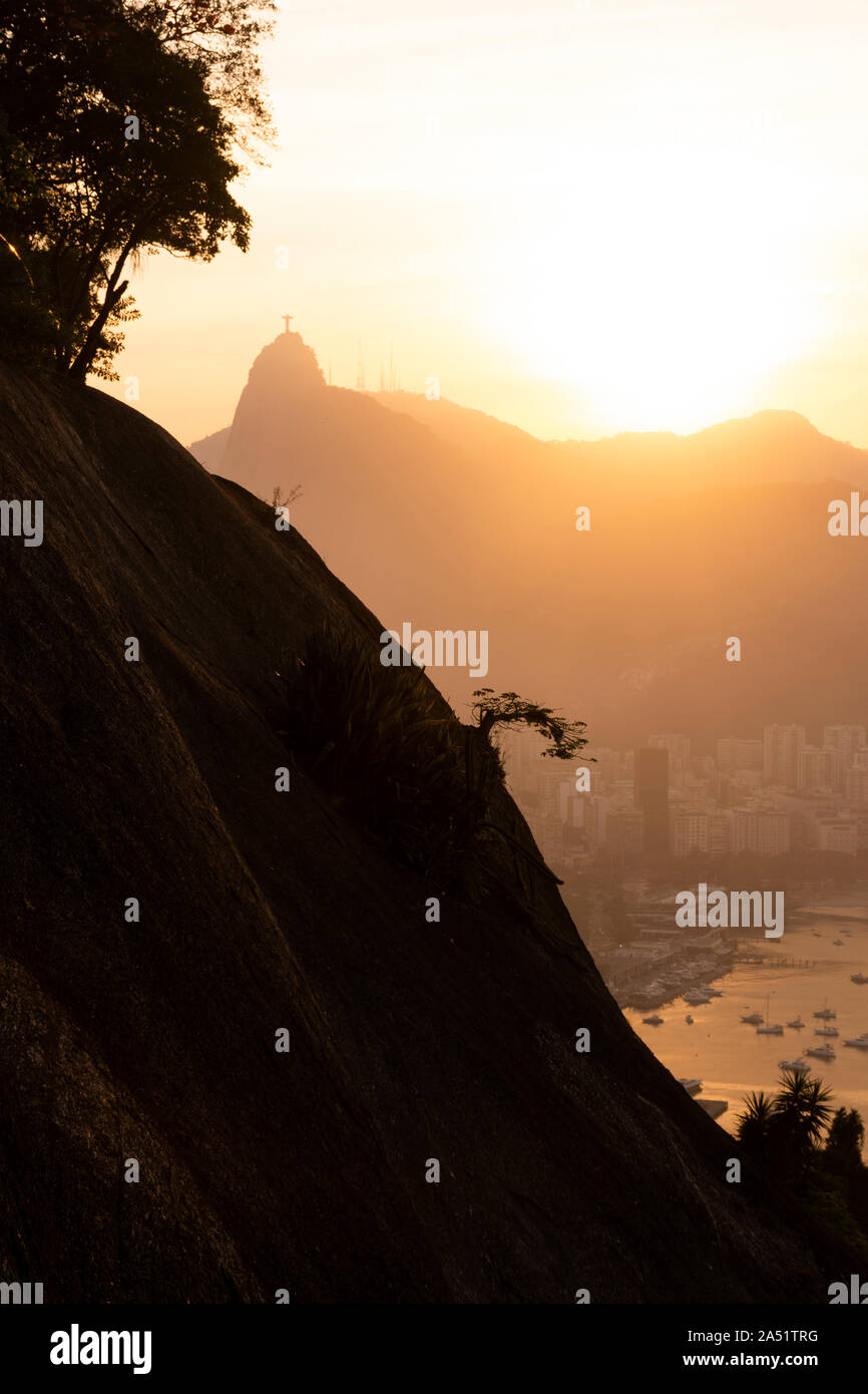 Beautiful sunset landscape of Christ the Redeemer and Corcovado Mountain seen from the Sugar Loaf, Rio de Janeiro, Brazil Stock Photo