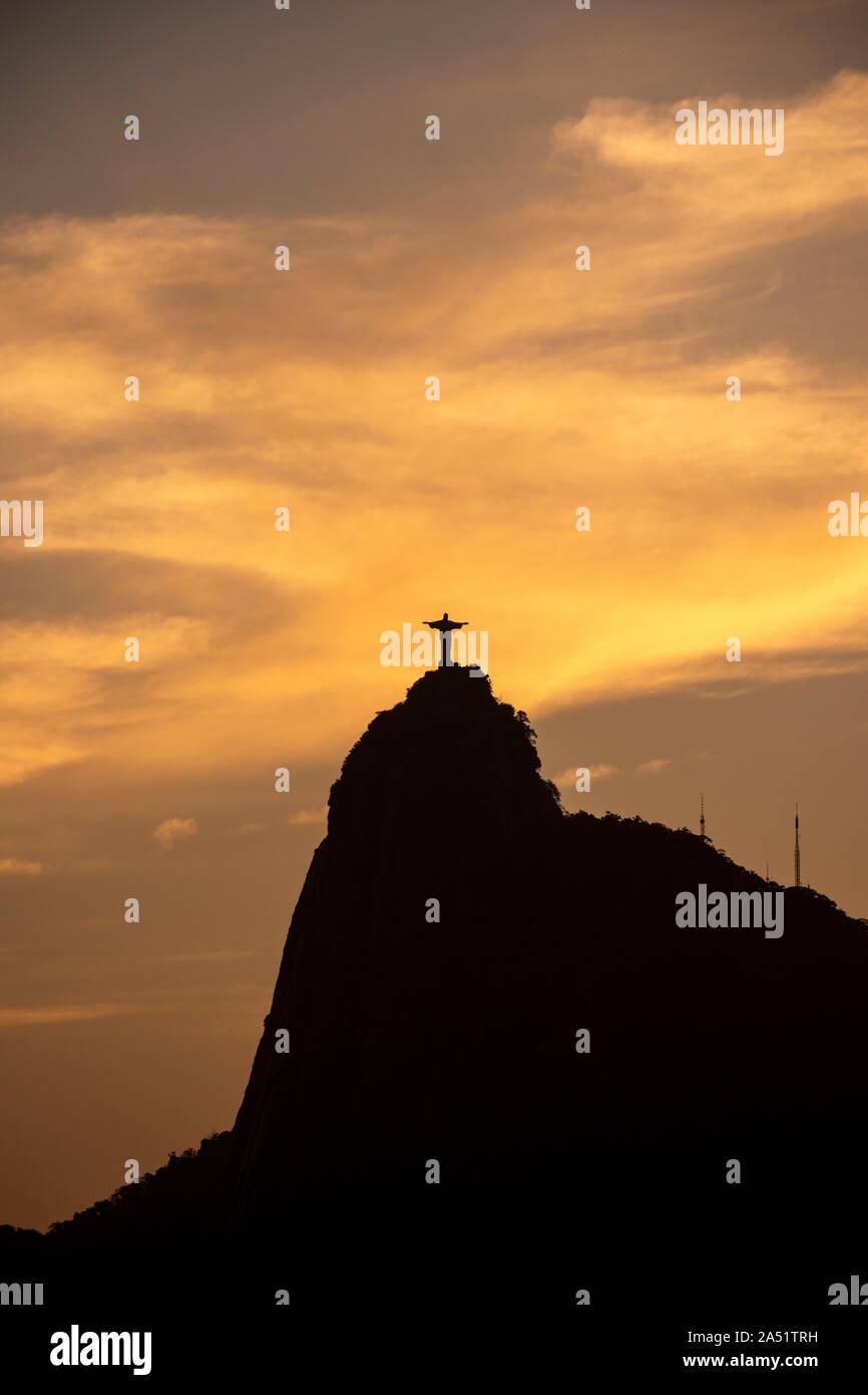 Beautiful sunset view from Mureta da Urca to Corcovado Mountain and Christ the Redeemer, Rio de Janeiro, Brazil Stock Photo
