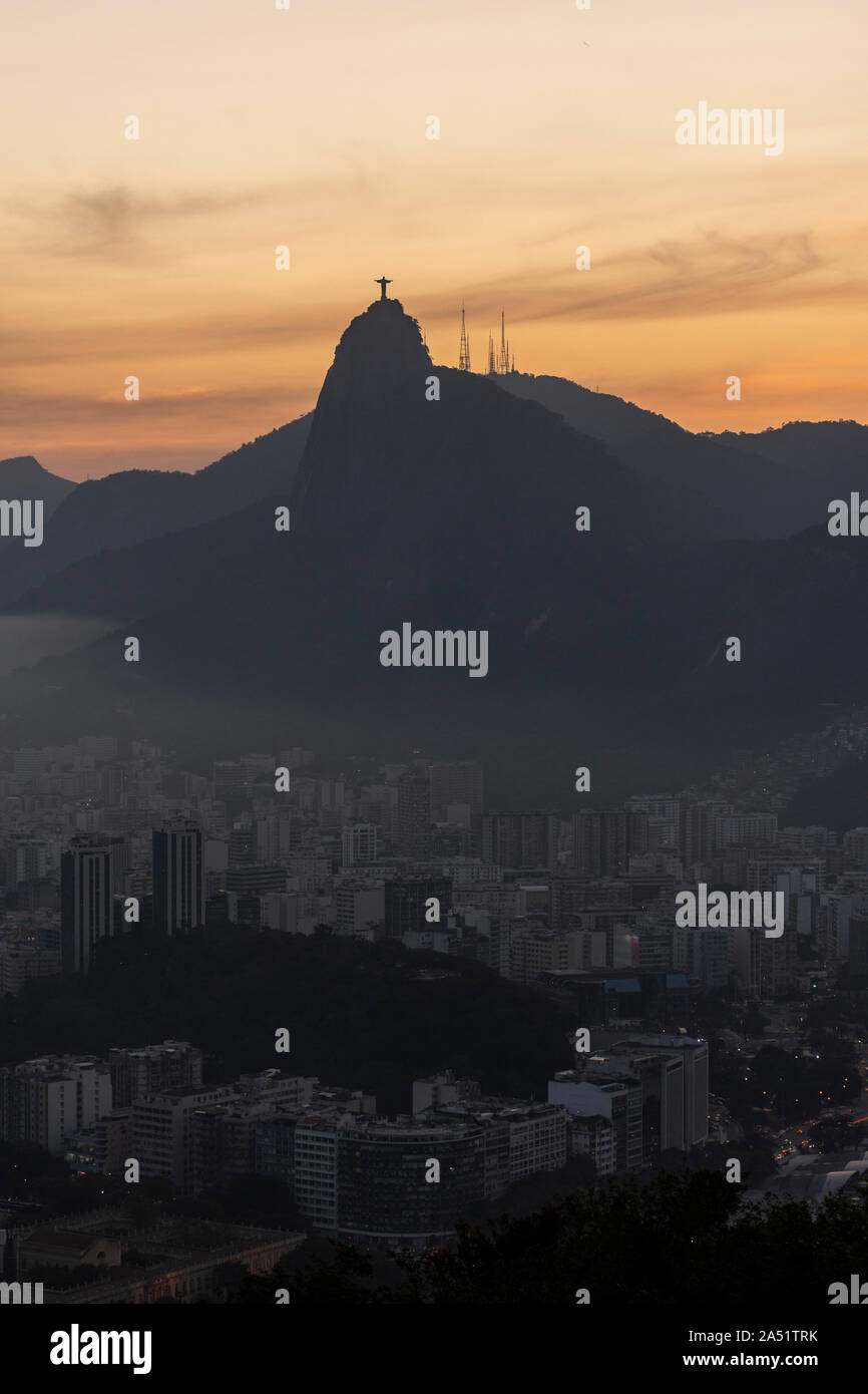 Landscape of Christ the Redeemer and Corcovado mountain in Rio de Janeiro on sunset time, Brazil Stock Photo