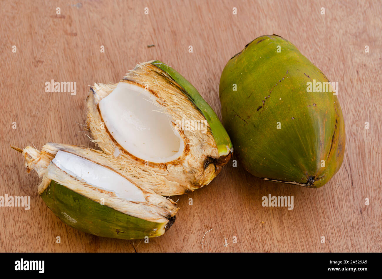 Whole And Cut Coconuts Stock Photo