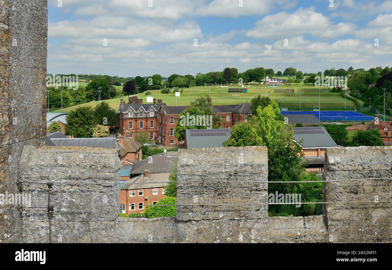 Part of Marlborough College, and sports field, seen from the tower of St Peter's church. Stock Photo