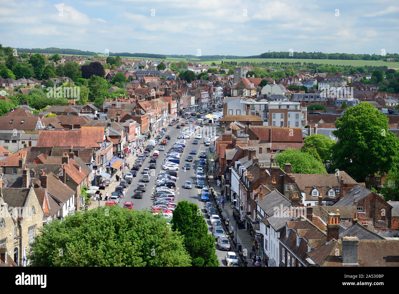 Rooftop view across the market town of Marlborough, Wiltshire, looking along the High Street from the tower of St Peter's church. Stock Photo