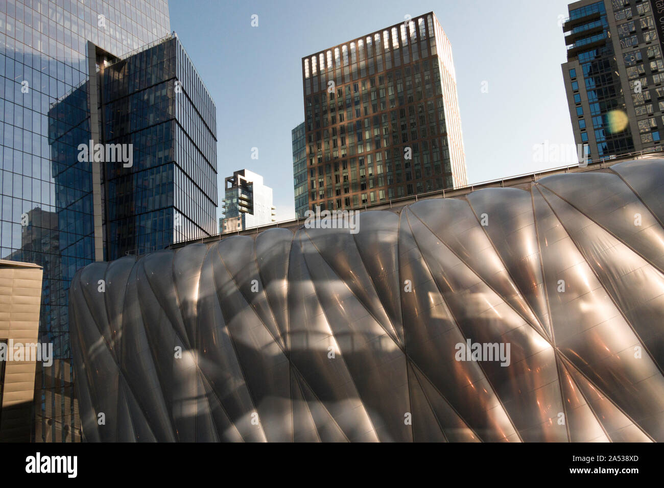 The Vessel structure and The Shed, a cultural venue, are in  the Hudson Yards Complex, New York City, USA Stock Photo