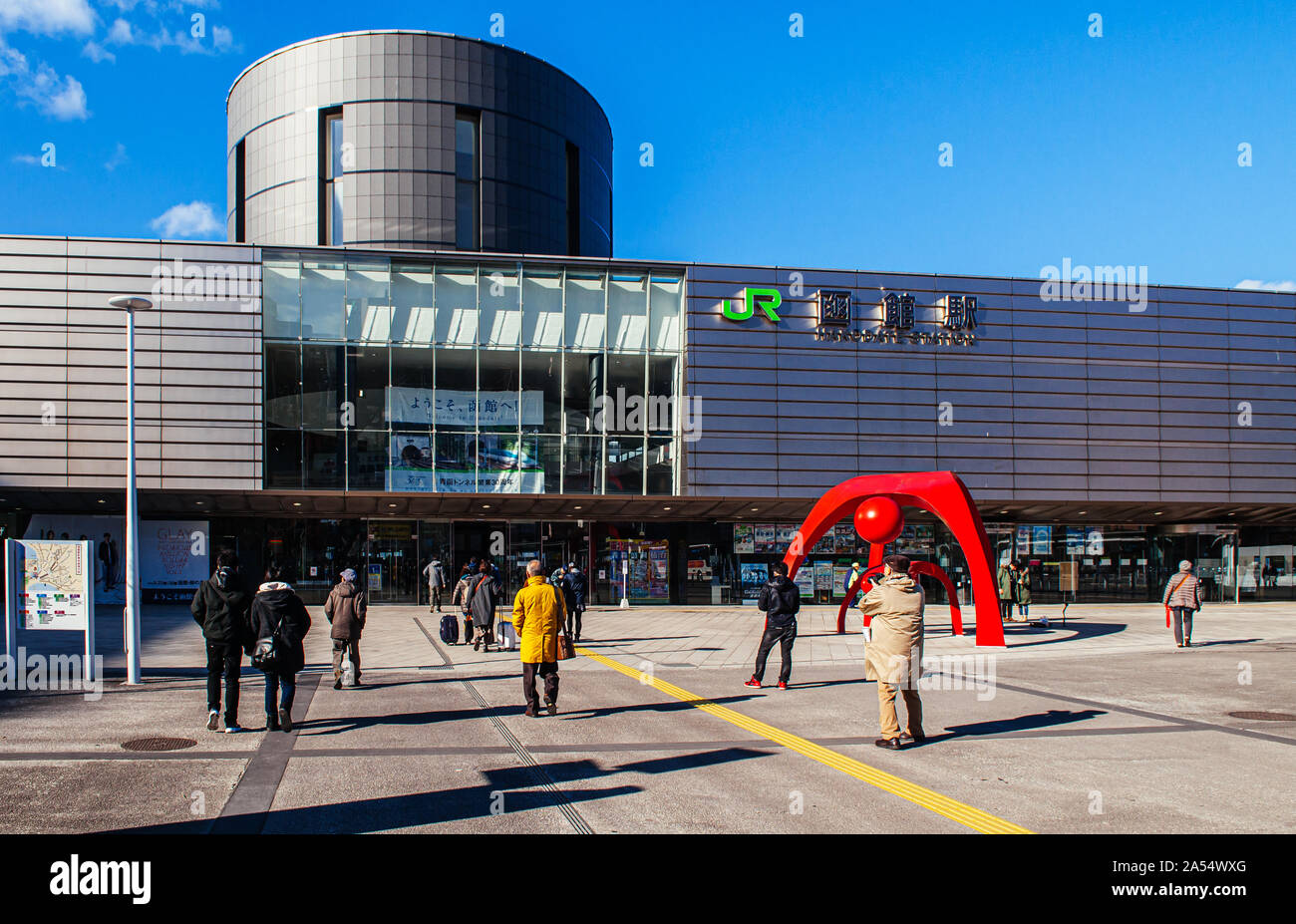 DEC 2, 2018 Hakodate, JAPAN - JR JR Hakodate Station building with tourists at front square under bright sunlight in winter Stock Photo