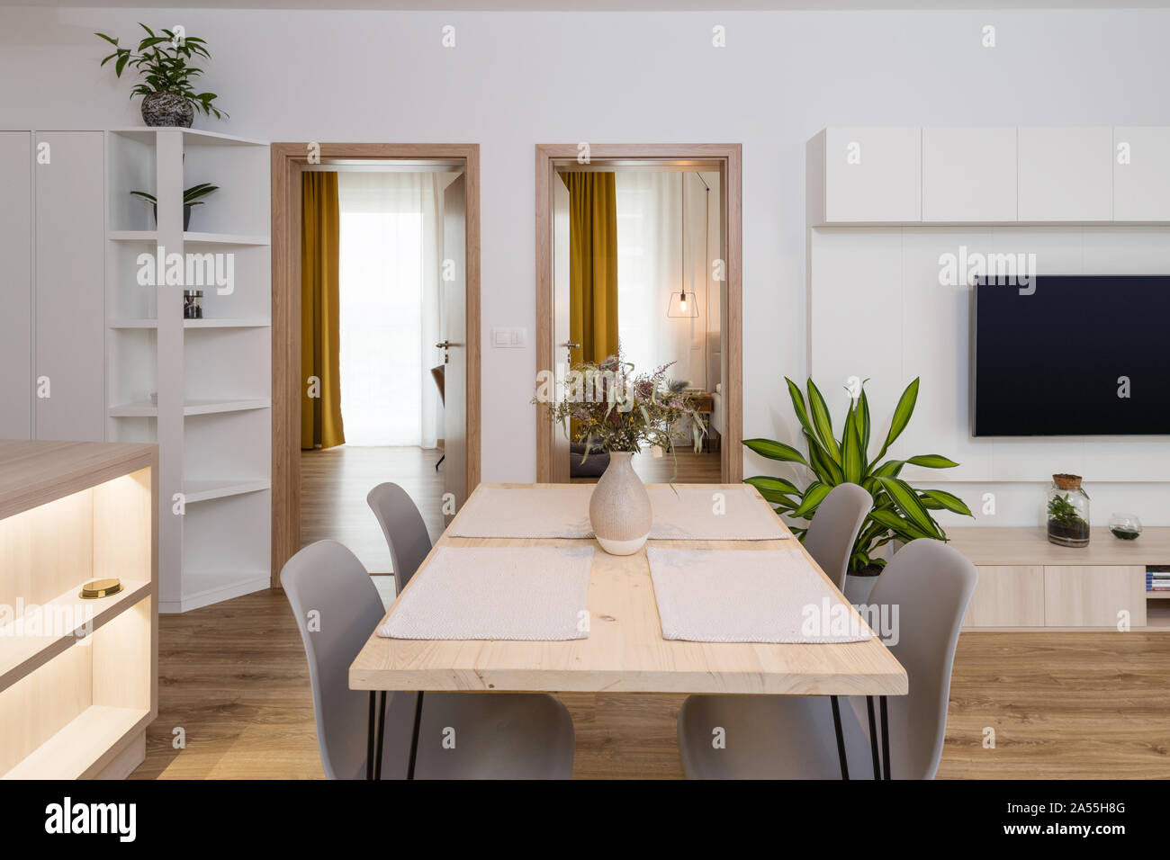 Dining table between kitchen and living room in contemporary ...