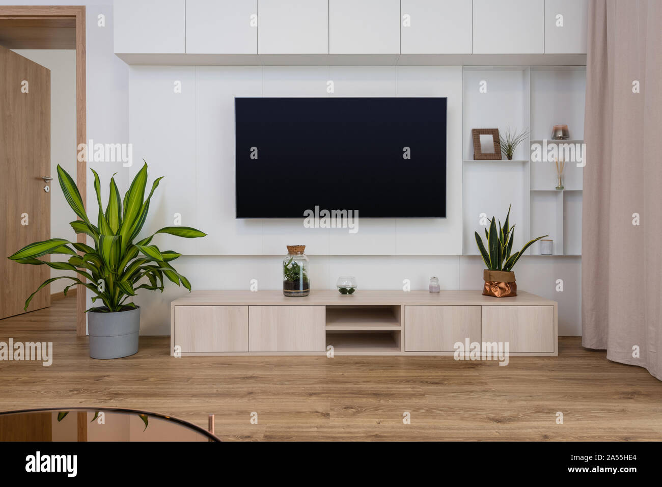 Interior Of Contemporary Living Room With Tv On The Wall Stock Photo Alamy