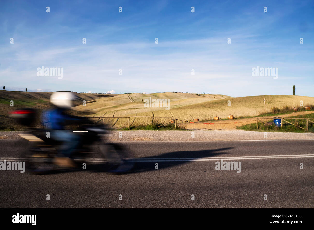 Speed of a biker versus the tranquility of nature Stock Photo