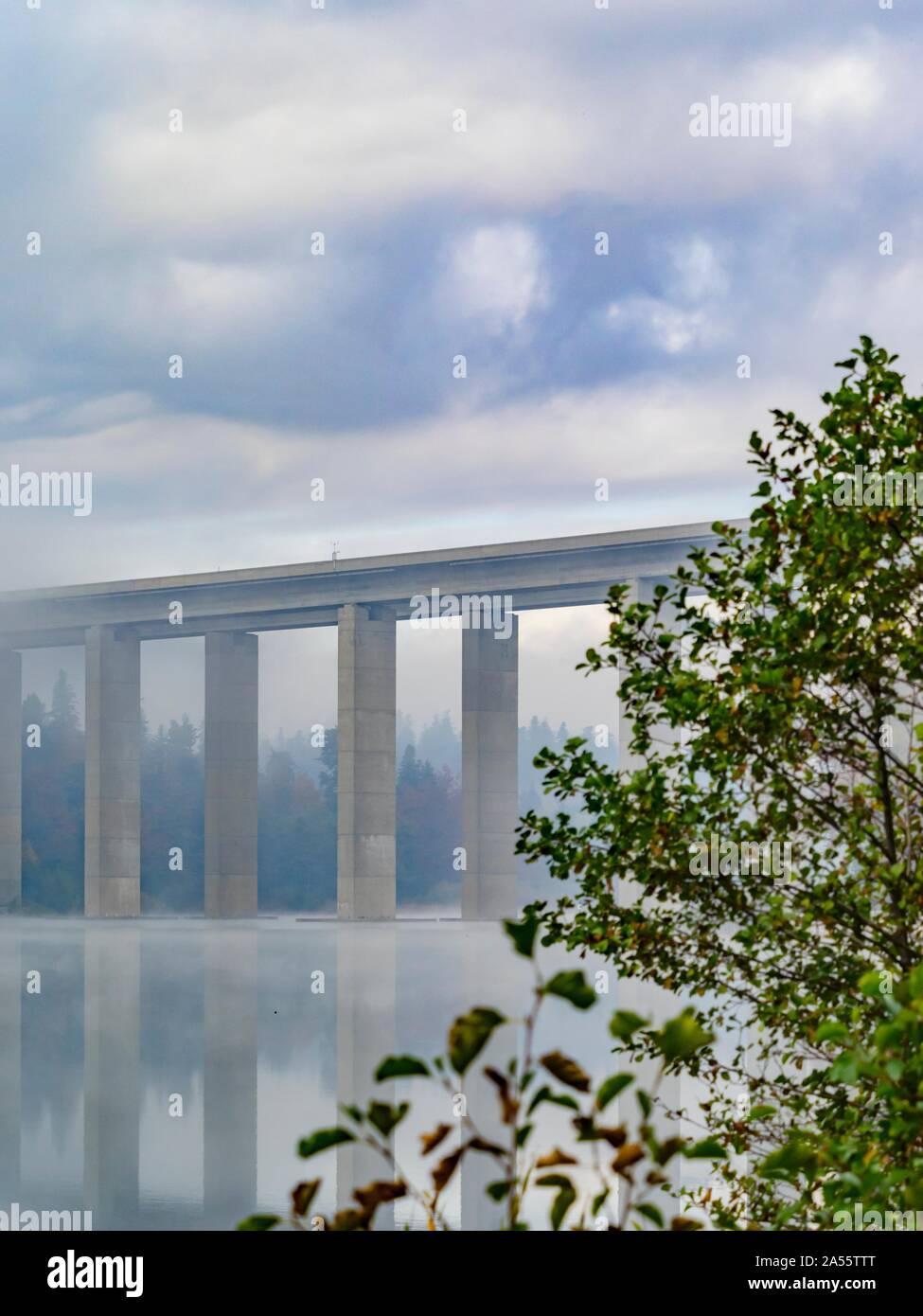 Road highway bridge accross lake Bajer near Fuzine in Croatia Stock Photo