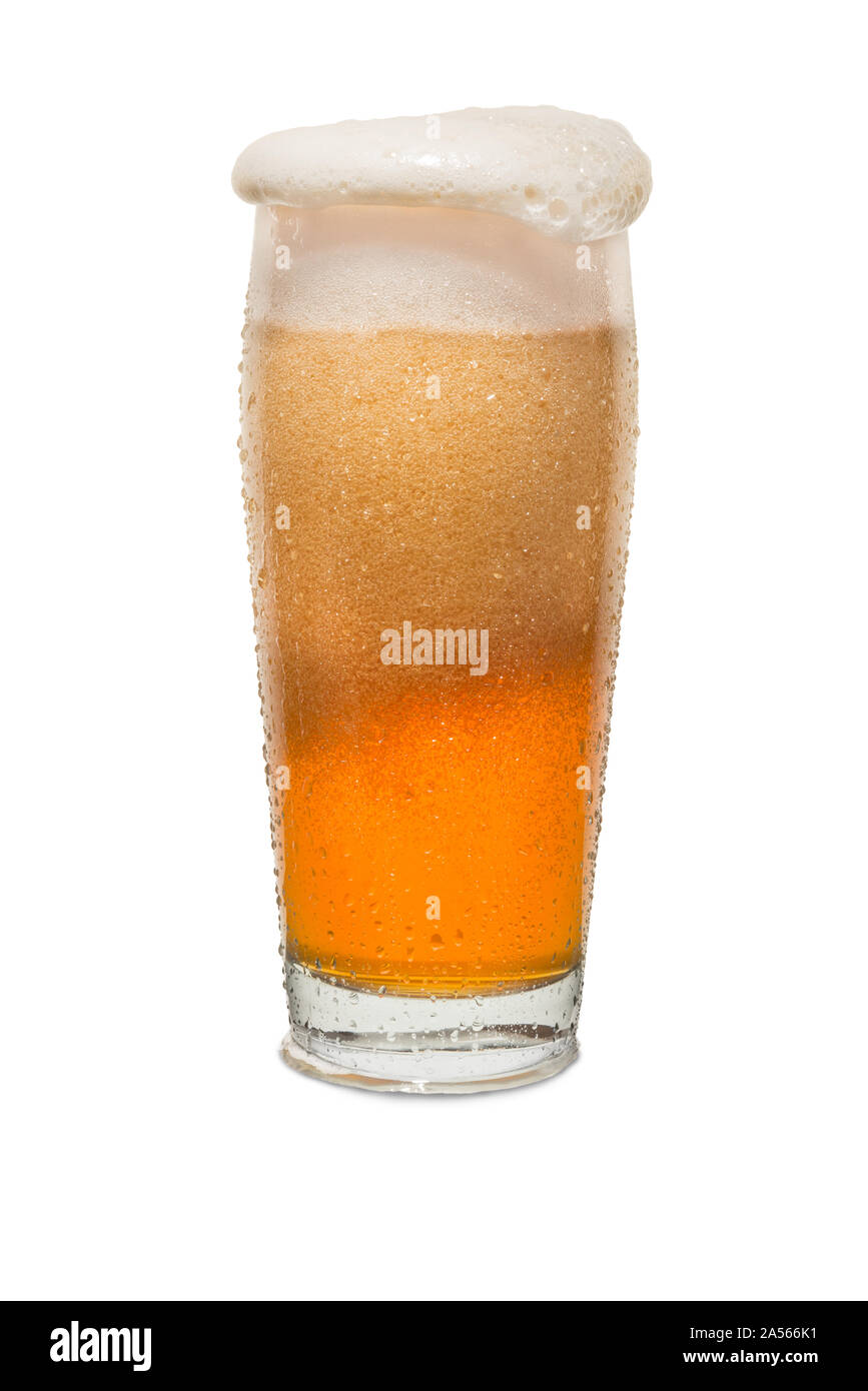 Sweated Craft Pub Beer Glass Overflowing with Beer #1. Stock Photo