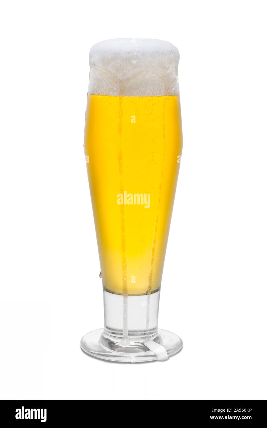 Classic Pilsner Beer with Foam Head and Drips Running Over Rim #3. Stock Photo