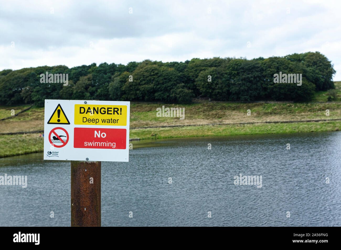 Danger deep water and no swimming sign next to a reservoir Stock Photo