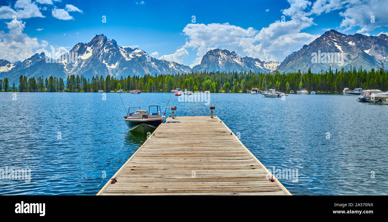 Motoboat dock on Jackson Lake at Coulter Bay. Stock Photo