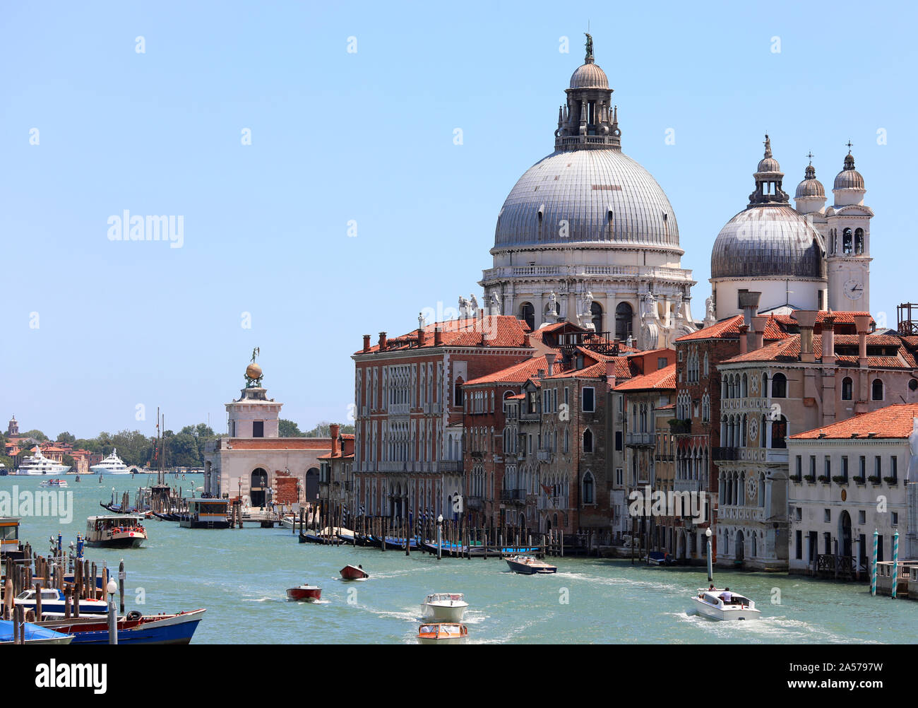 Dome of the Church of Madonna della Salute and boats on the Grand Canal the  maimn waterway of Venice in Italy Stock Photo - Alamy