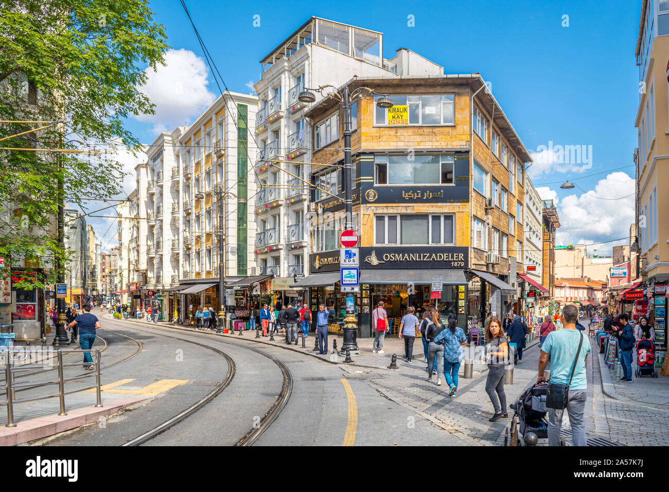Tourists and local Turks enjoy a summer day in the Sultanahmet district of shops and cafes in Istanbul, Turkey. Stock Photo
