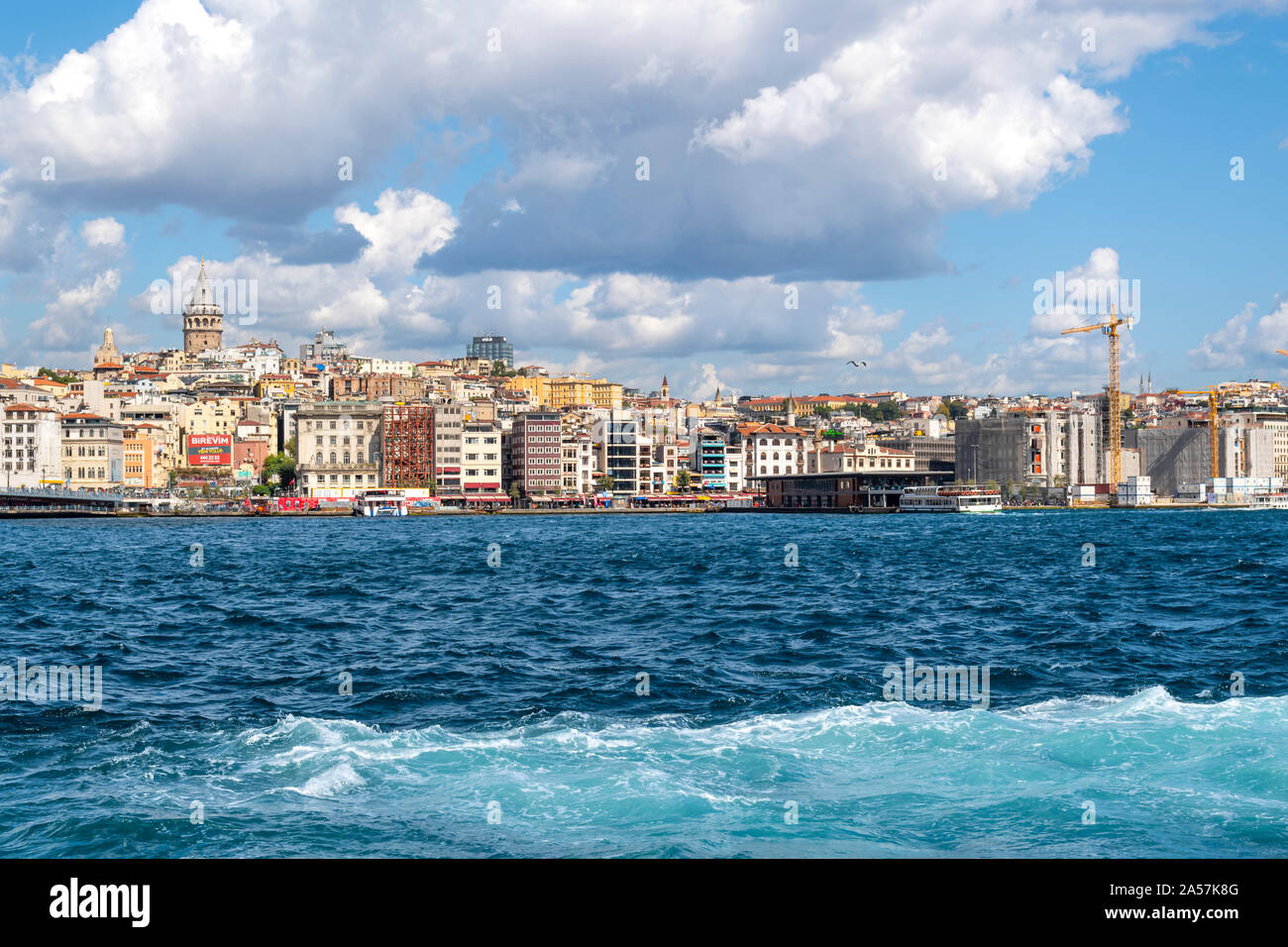 A view of the ancient Galata Tower, the Galata Bridge, the Bosphorus river and skyline of Istanbul, Turkey at the Golden Horn. Stock Photo