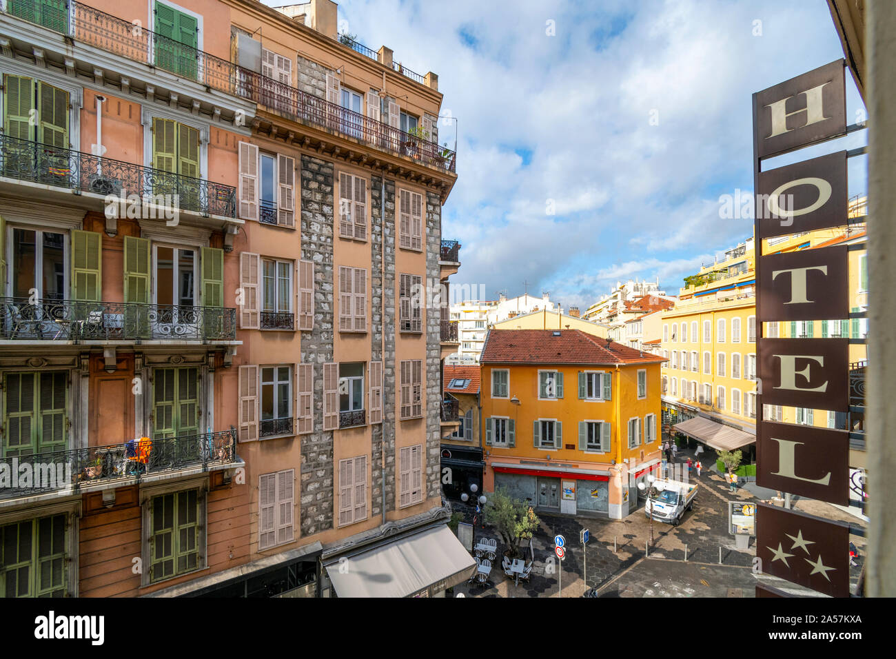 View from a hotel balcony overlooking the touristic urban center of Nice France on the French Riviera. Stock Photo