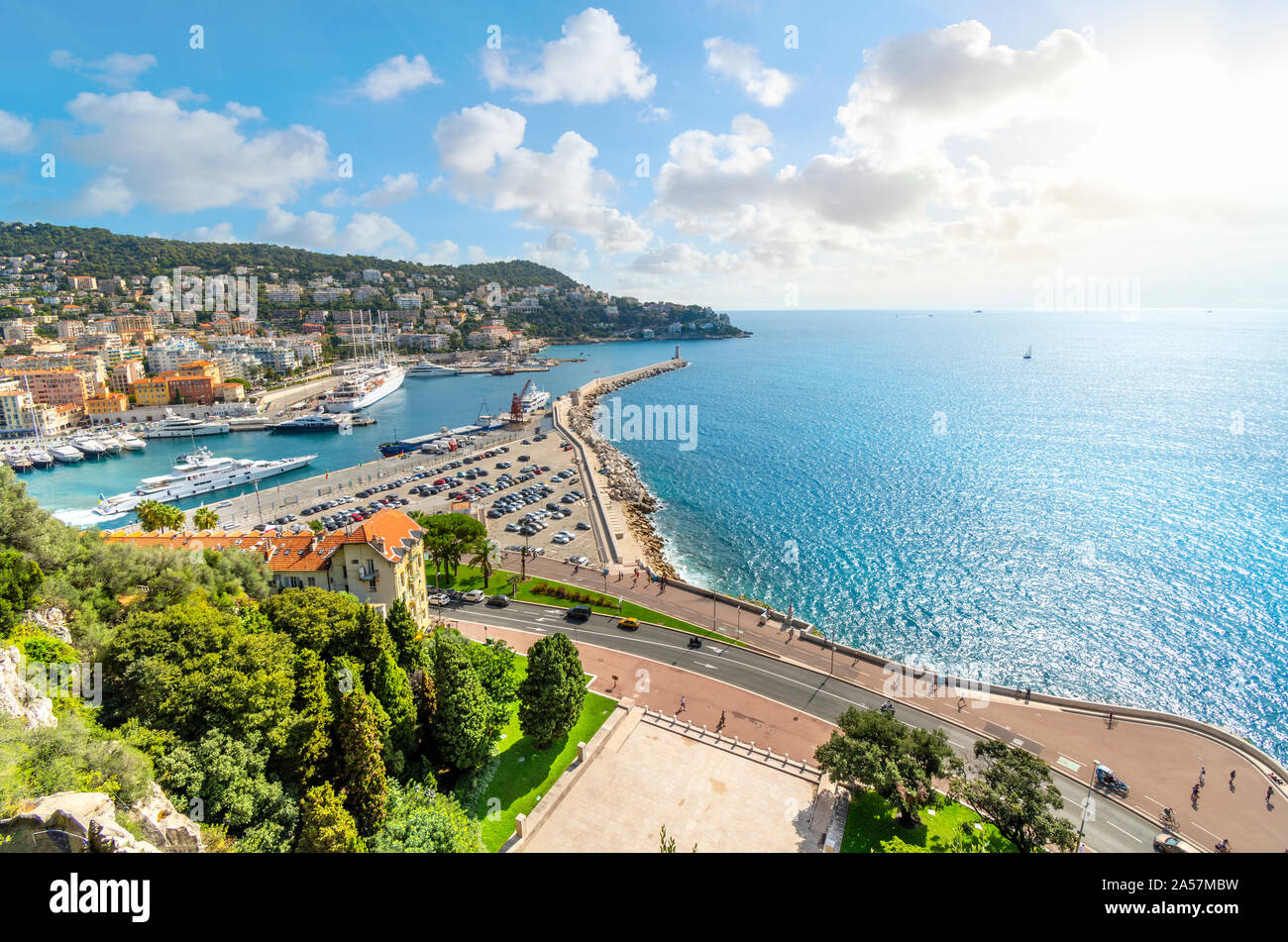 View from atop Castle Hill overlooking The Mediterranean Sea, promenade and the old harbor and port on the French Riviera, in Nice France. Stock Photo