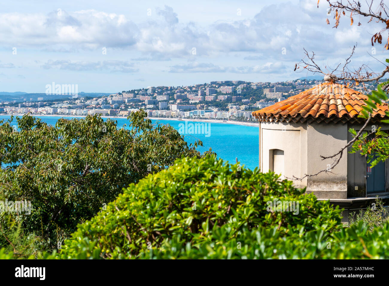 View of the turquoise Mediterranean Sea, beach, Bay of Angels, city and Castle Hill elevator from a lower lookout area on Castle Hill in Nice France Stock Photo