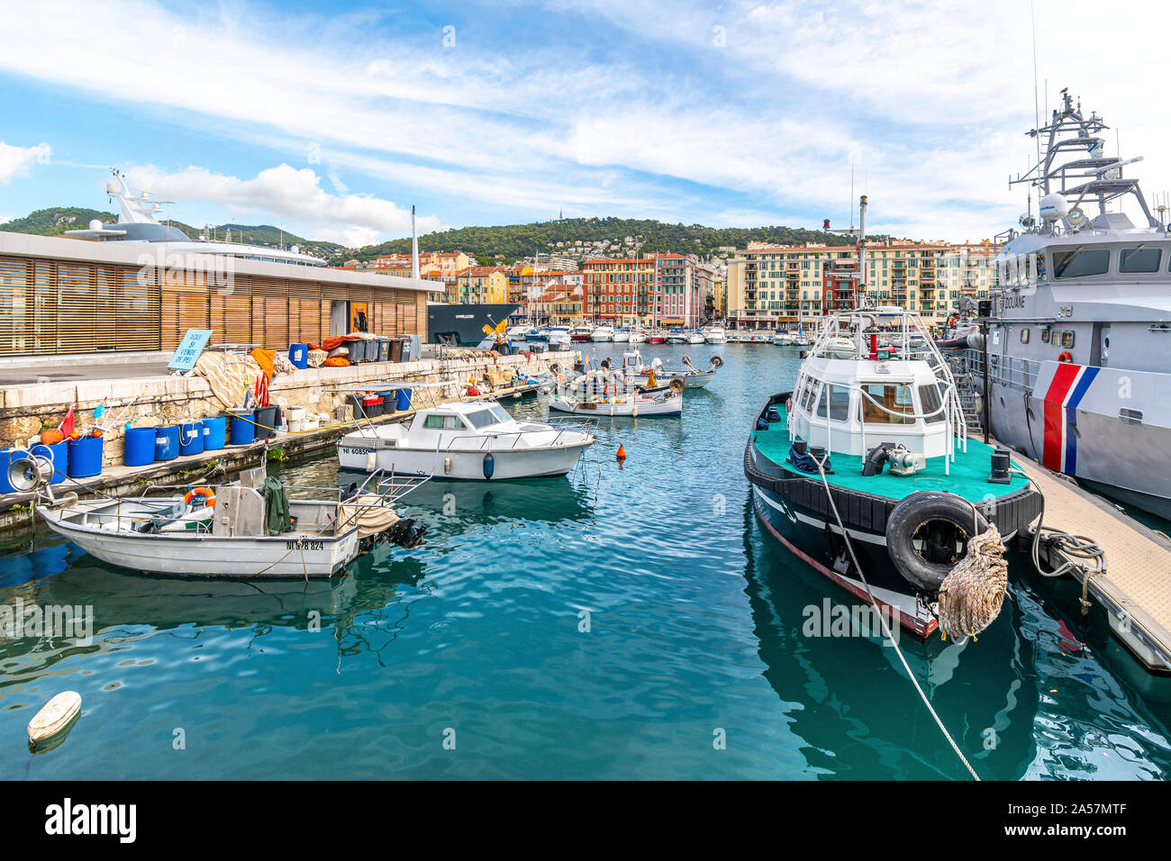 An assortment of boats and watercraft in the old harbor of Port Lympia in the city of Nice France, on the Mediterranean Sea at the French Riviera. Stock Photo