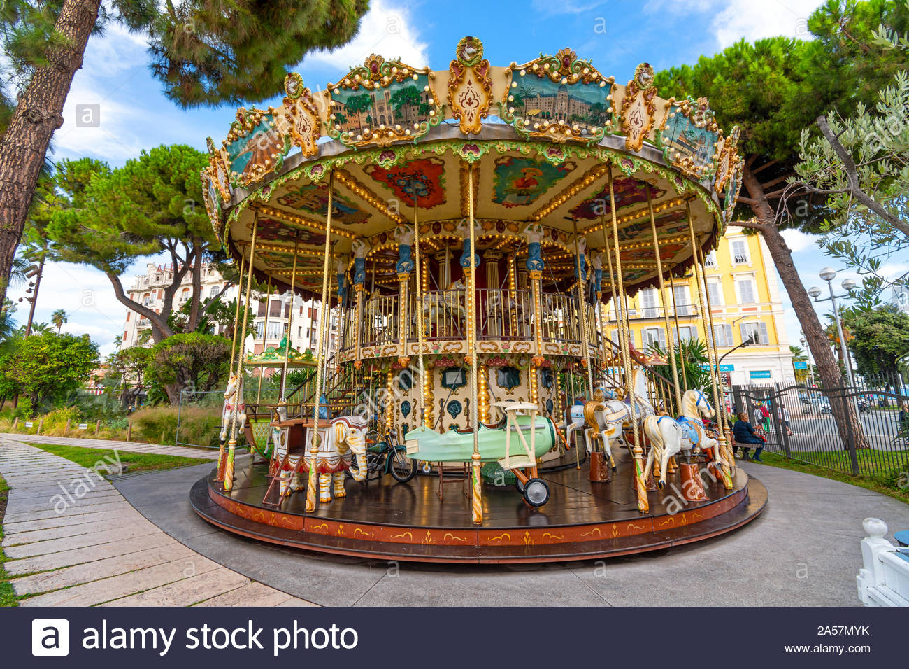 The colorful carousel at Albert I Garden, or Jardin Albert 1er in Vieux or Old City in the Mediterannean city of Nice France on the French Riviera Stock Photo
