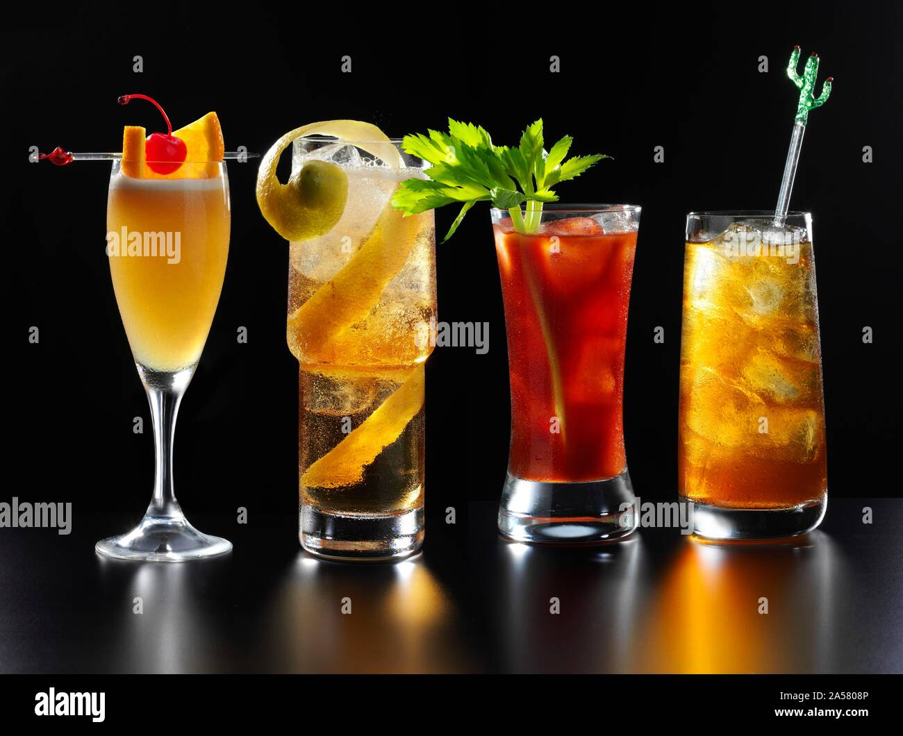Four different fruity cocktails, black background, Germany Stock Photo