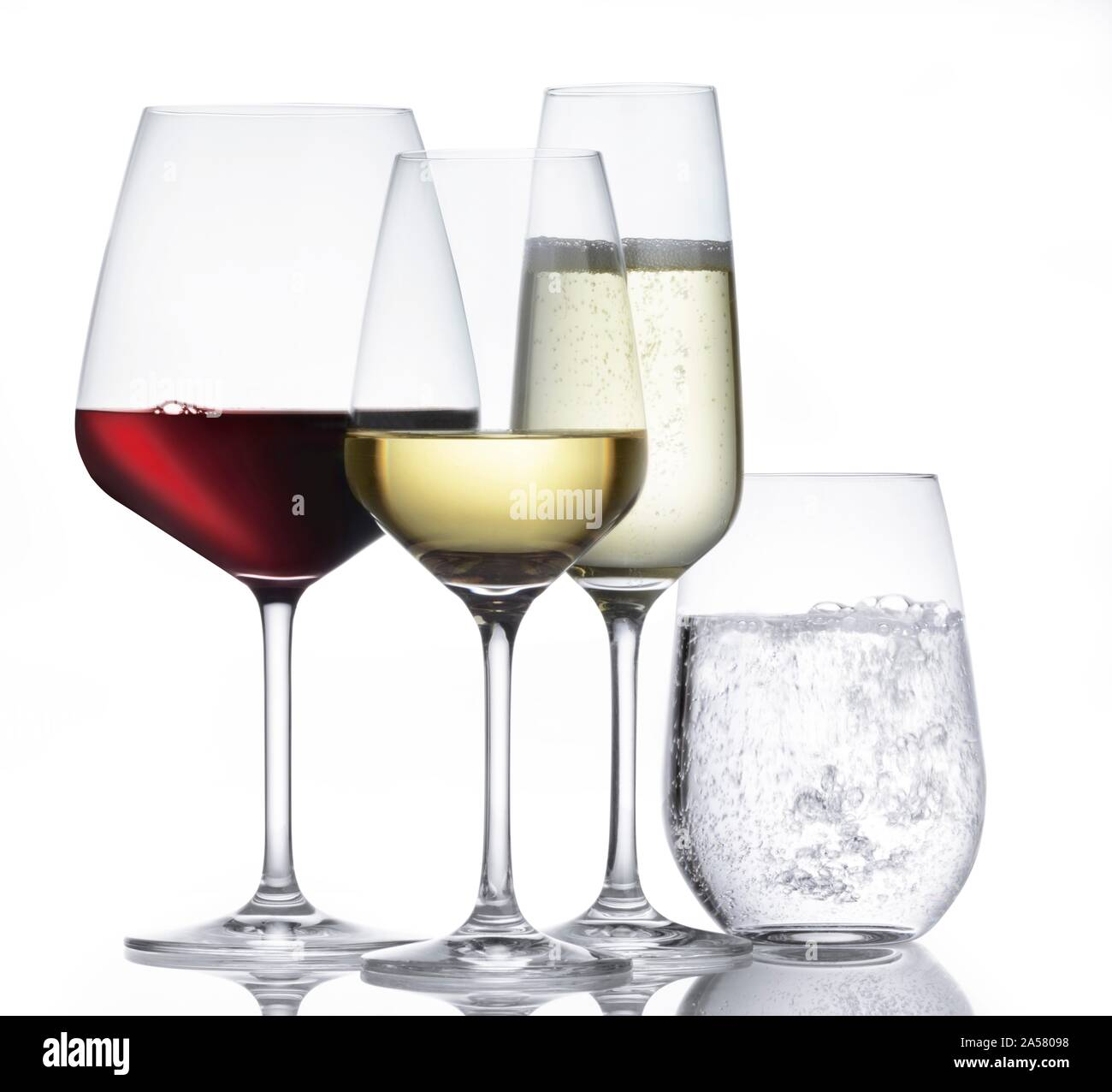 Various glasses, wine glasses with red wine and white wine, champagne glass and water glass, studio shot, cutout, white background, Germany Stock Photo
