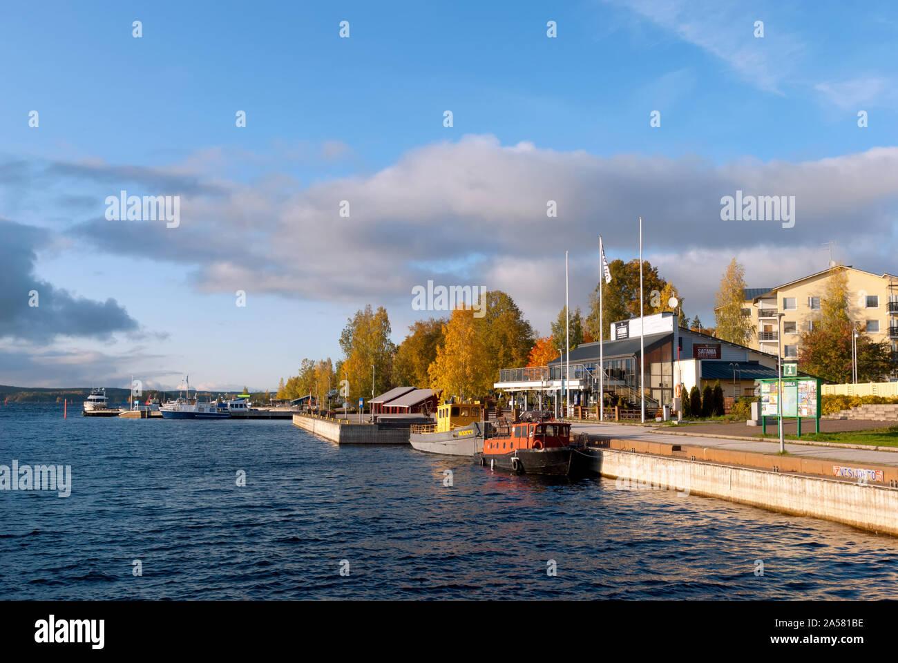Puumala, Finland–October 5, 2019: Boats on the bank of The Saimaa Lake and residential buildings. Puumala Municipality. Southern Savonia (Savo) Region Stock Photo