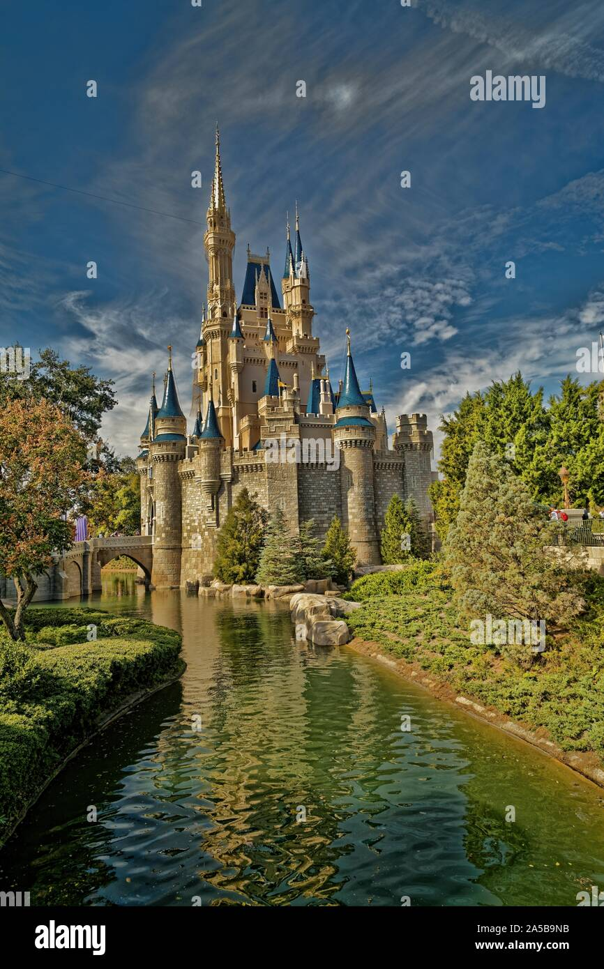 Cinderella's castle in Magic kingdom, Disney world, Orlando  Daylight view with clouds in the sky in background Stock Photo