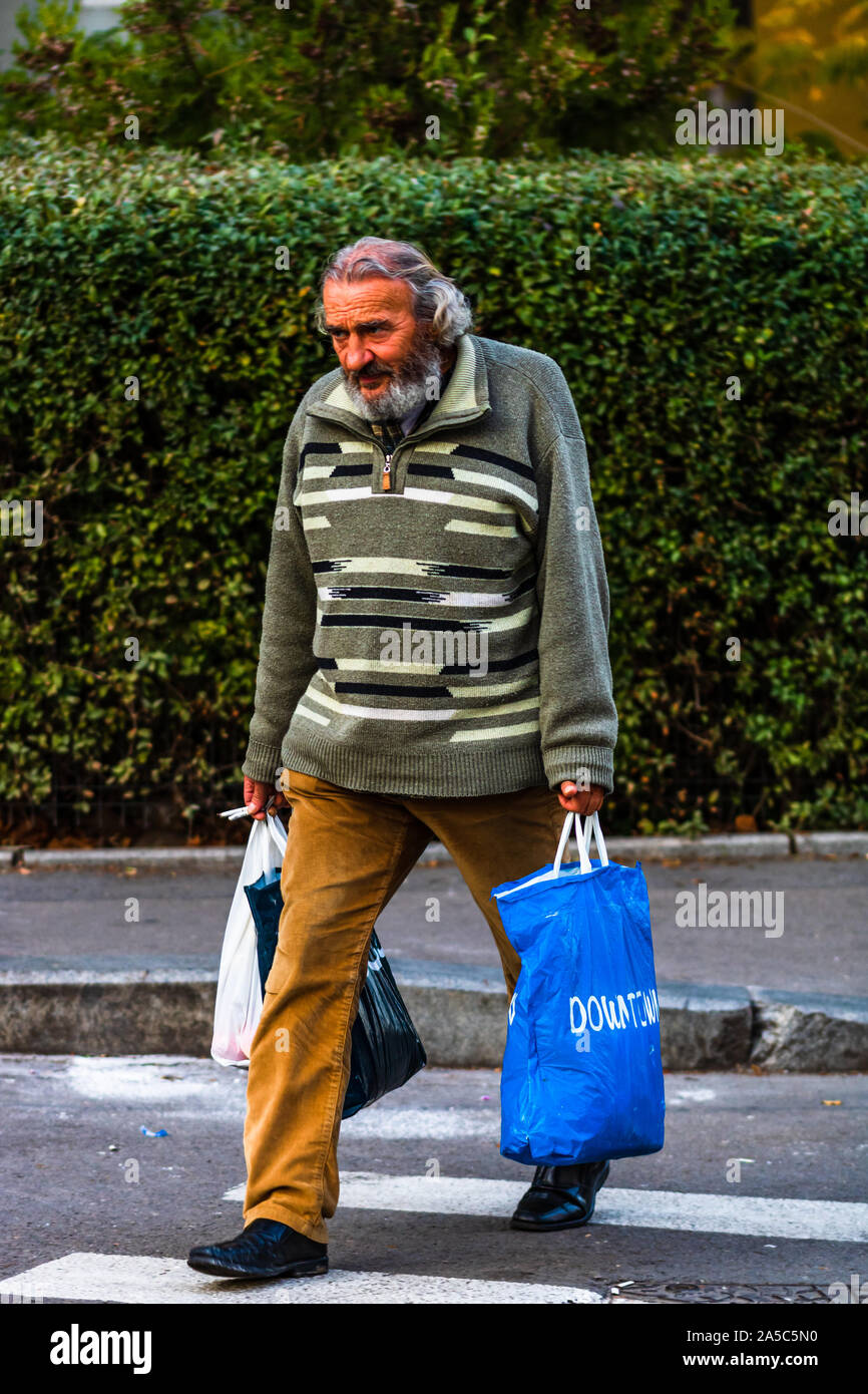Old Man Crossing The Street And Carrying Bags Of Groceries In Bucharest Romania 2019 Stock Photo Alamy