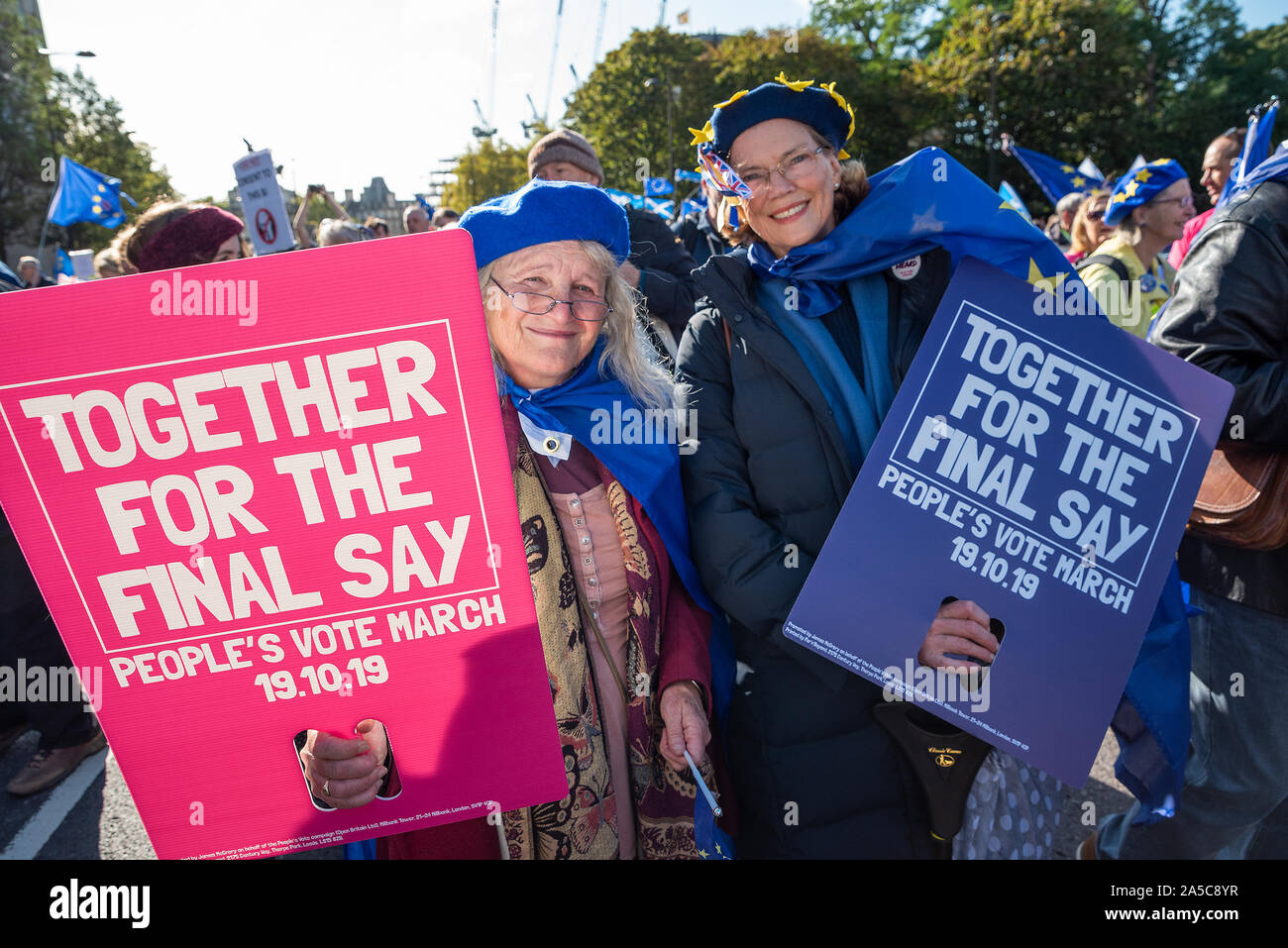 London, UK, 19 Oct 2019. Peoples Vote March. While Parliament debated the deal negotiated by PM Boris Johnson with the EU hundreds of thousands of anti Brexit protestors marched from Park Lane to Parliament Square. Pictured, two women marchers holding Together for the Final Say Peoples Vote placards. Credit: Stephen Bell/Alamy Stock Photo