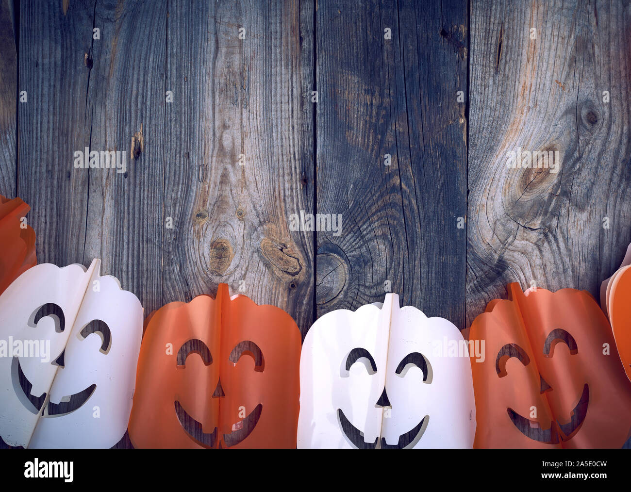 Plastic Garland On With Carved Figures Of Pumpkins Gray Wooden Background Backdrop For Halloween Stock Photo Alamy