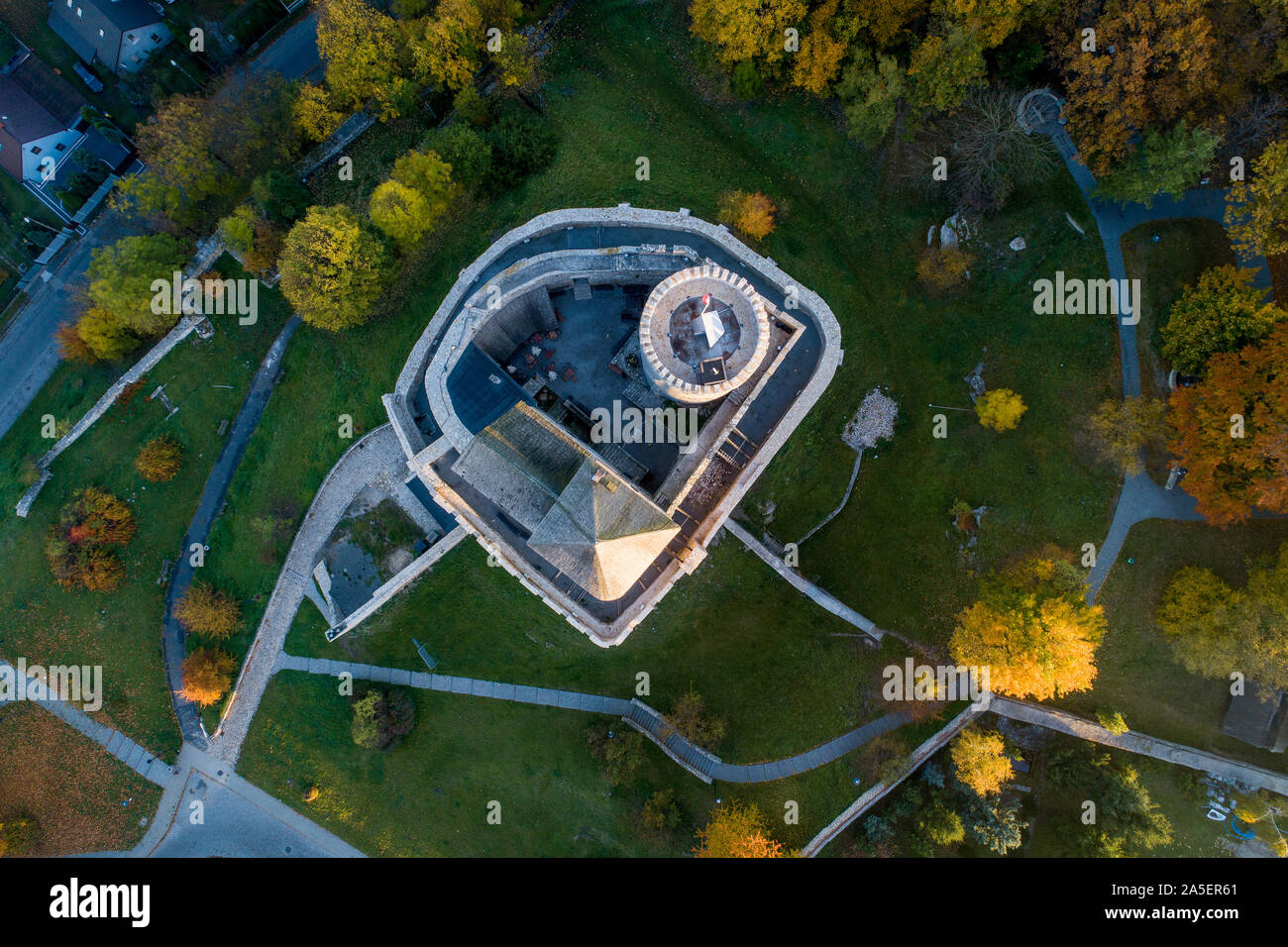 Medieval gothic castle in Bedzin, Upper Silesia, Poland. Aerial view from above in fall in sunrise light Stock Photo