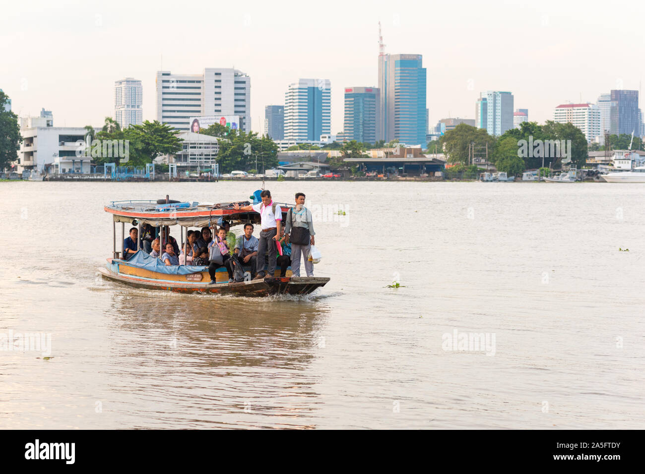 Bangkok, Thailand - September 25, 2018: commuters cross the Chao Phraya River on the ferry following from Khlong Toei to Bang Krachao. Stock Photo