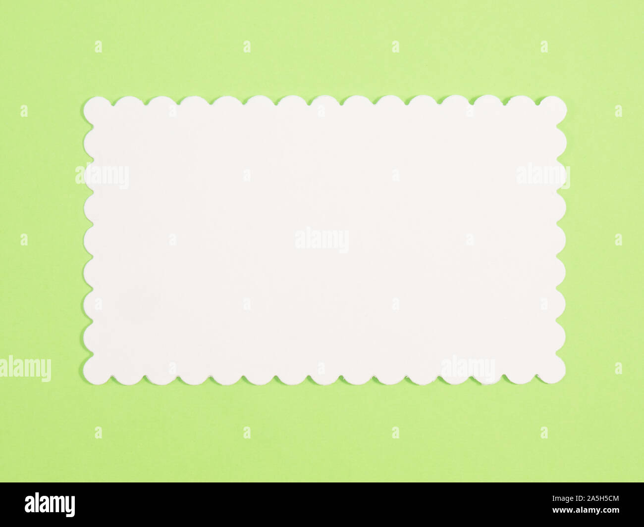 White name plate for copy space on green background Stock Photo