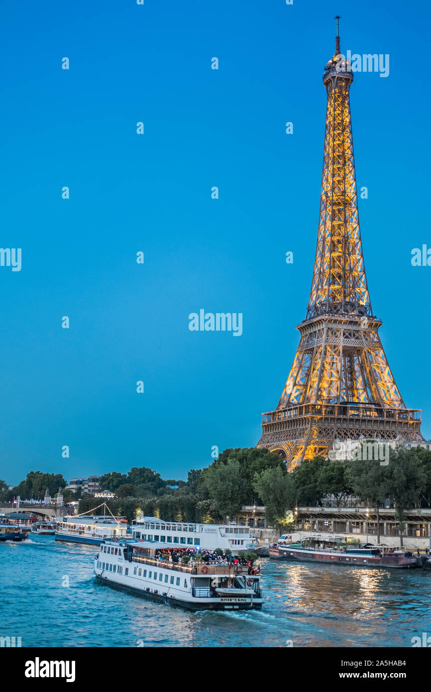 eiffel tower and sightseeing boats on river seine Stock Photo
