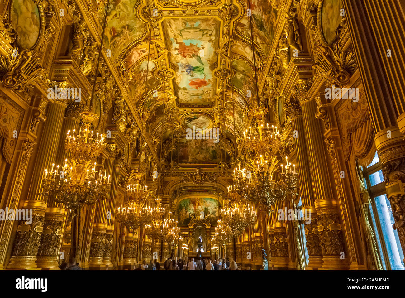 View of the beautiful Grand Foyer looking east. The hall of the famous Palais Garnier was designed to act as a drawing room for Paris society. Its... Stock Photo