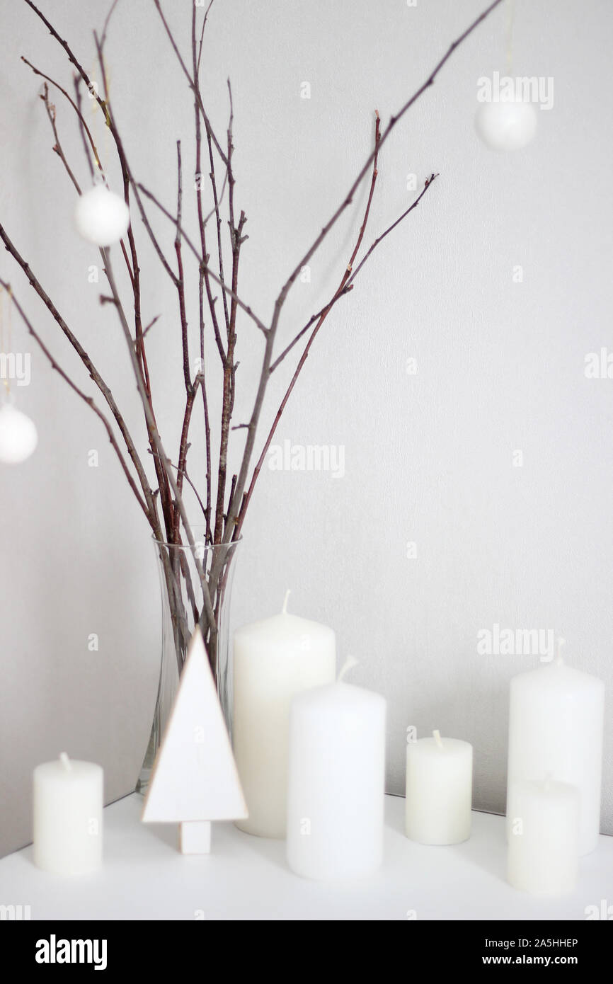 Minimal Scandinavian Christmas Decorations Holidays White Ornaments On The Tree Branches Candles Festive Home Decor For Winter Stock Photo Alamy