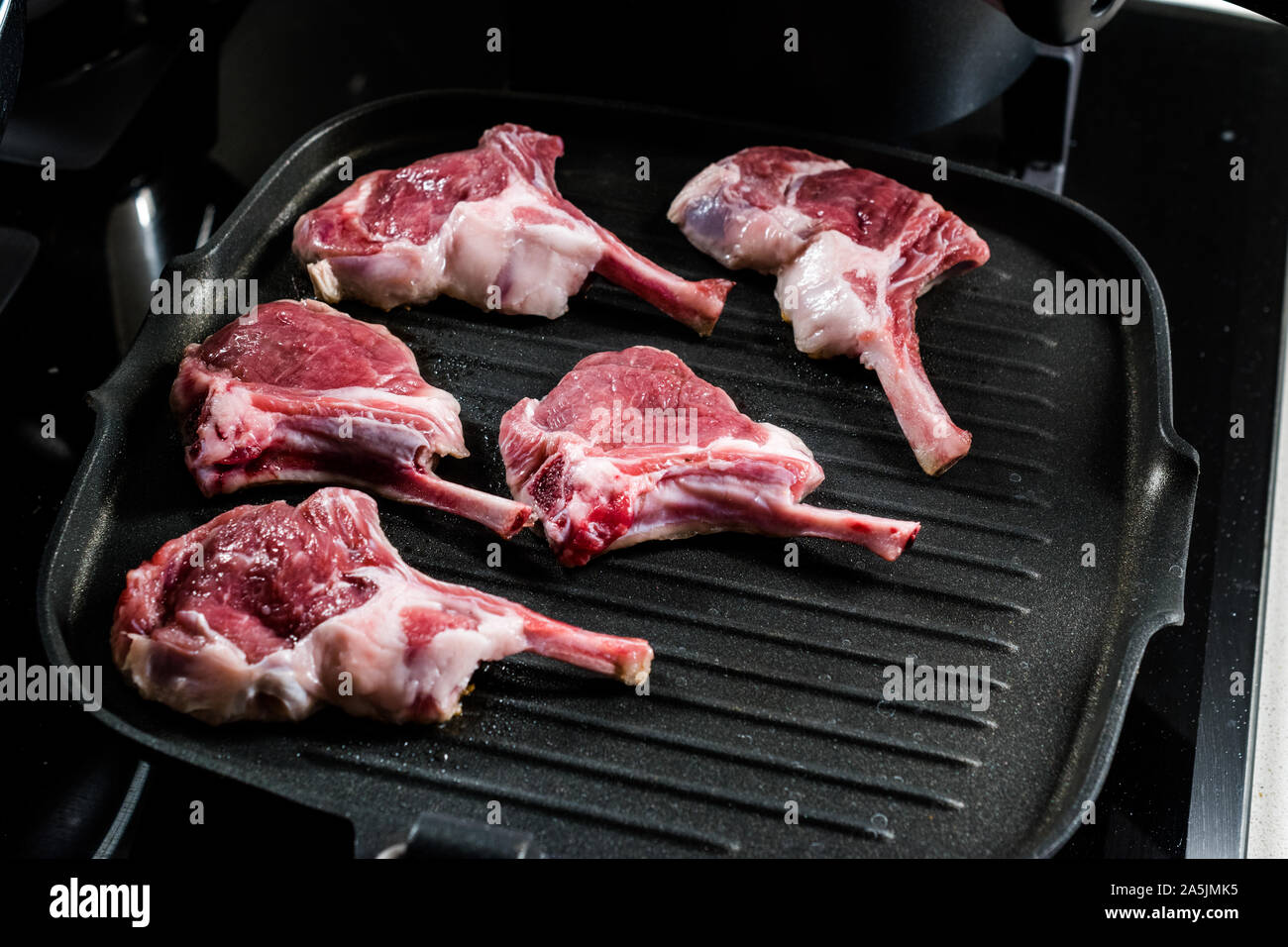 Raw Lamb Chops are Frying in Pan. Organic Meat Food. Stock Photo
