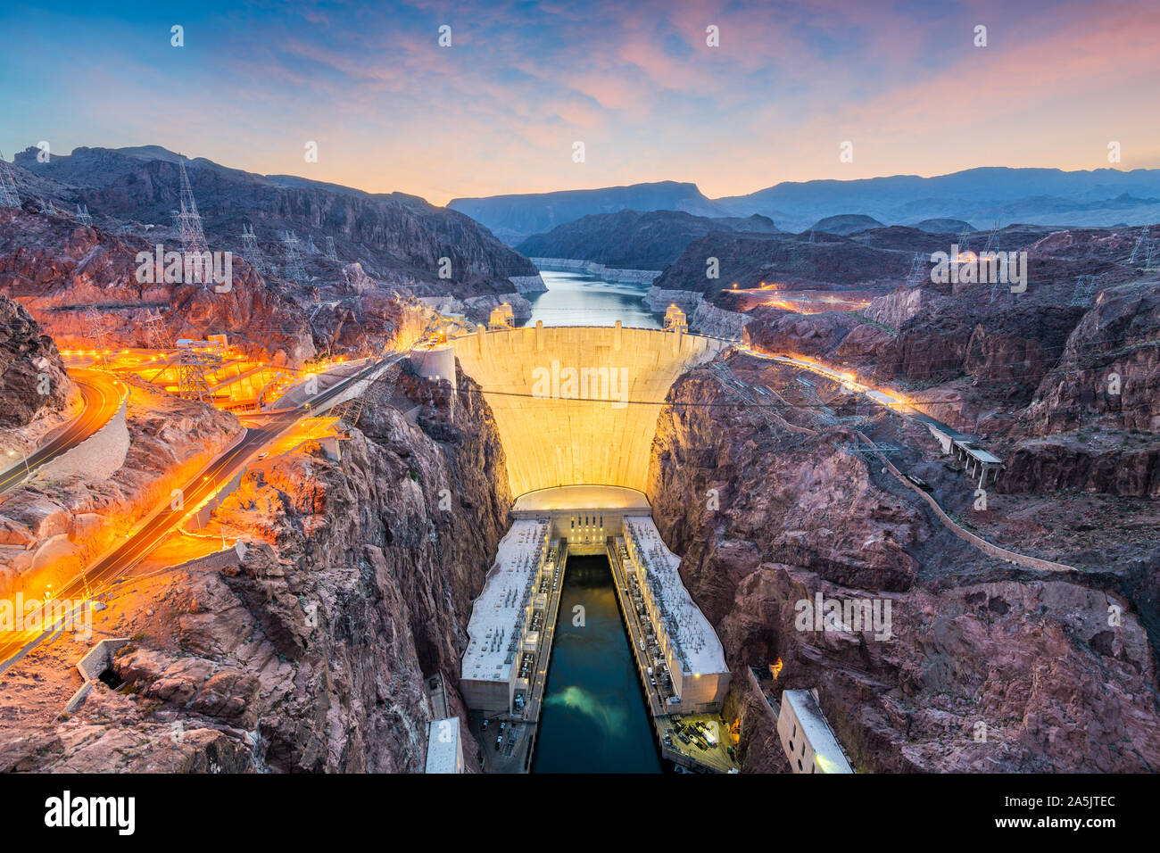Hooover Dam on the Colorado River straddling Nevada and Arizona at dawn. Stock Photo
