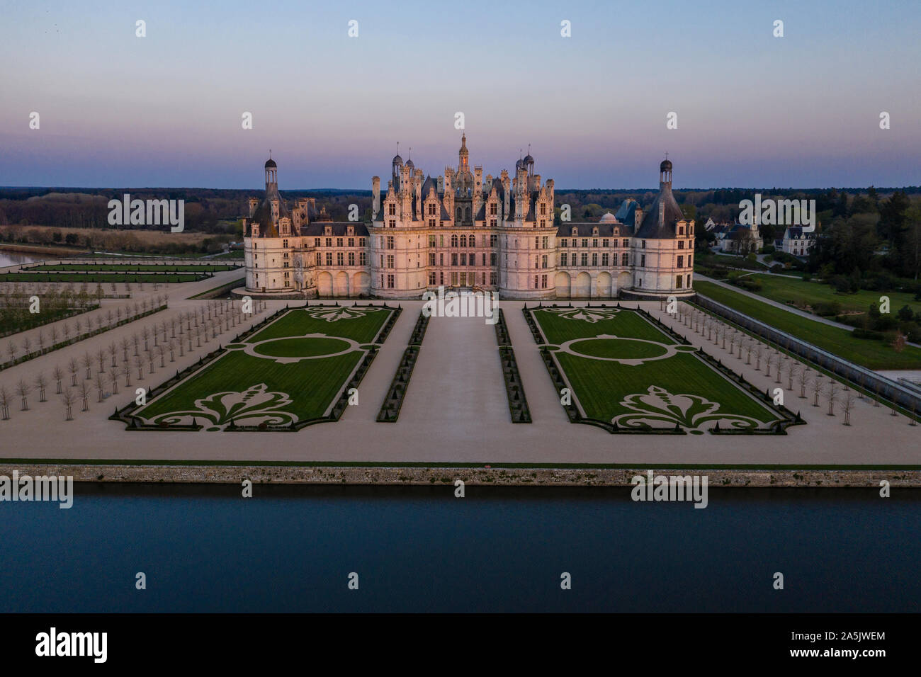 France, Loir et Cher, Loire Valley listed as World Heritage by UNESCO, Chambord, royal castle of Chambord and the French gardens at sunset (aerial vie Stock Photo