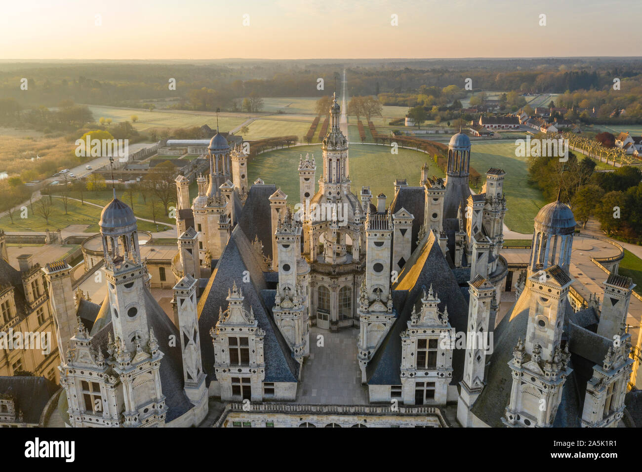 France, Loir et Cher, Loire Valley listed as World Heritage by UNESCO, Chambord, royal castle, views on the roofs and chimneys, sunrise (aerial view) Stock Photo