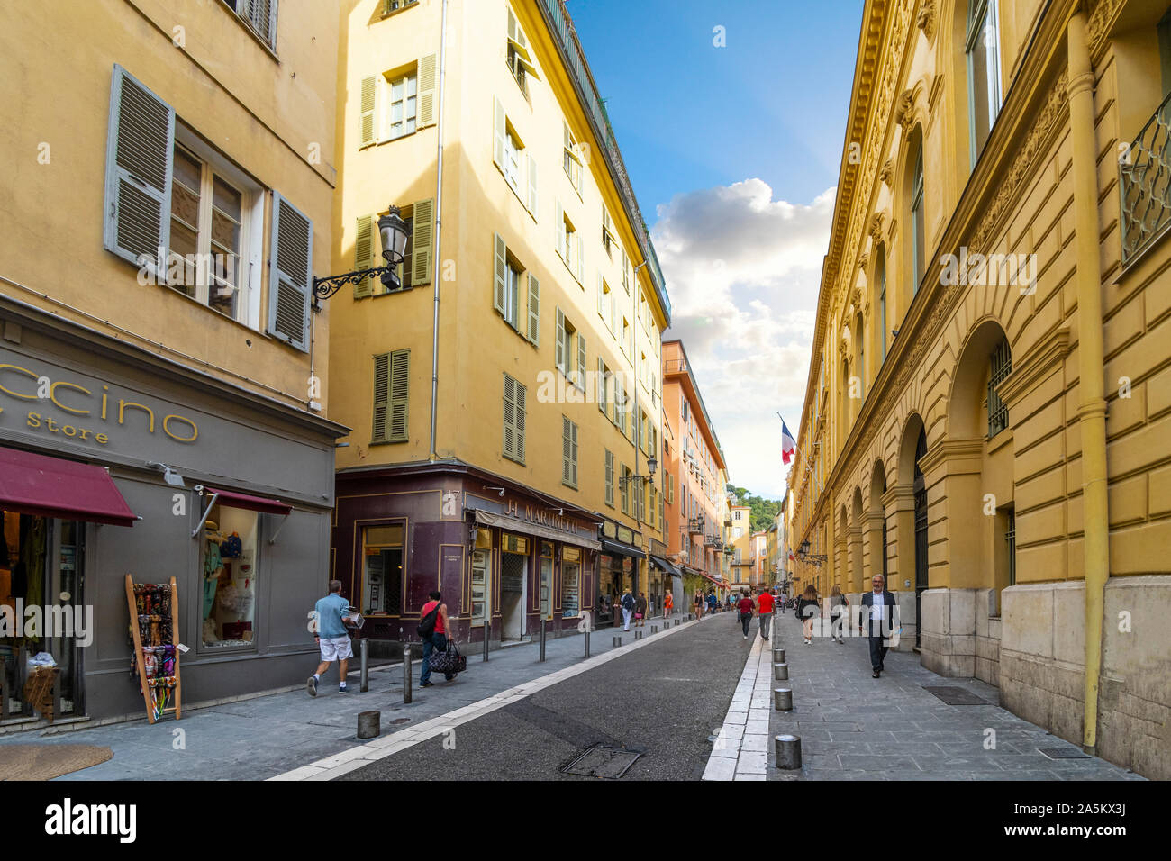 One of the main streets leading to Old Town or Vieux Nice in the historic city of Nice, France, on the French Riviera. Stock Photo