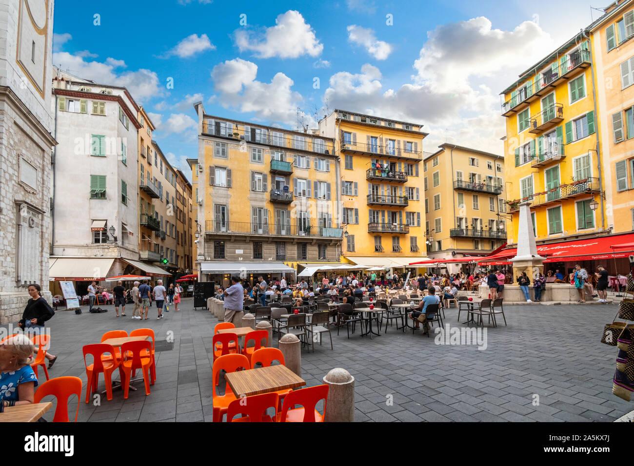 Tourists enjoy a late afternoon at the shops and cafes at Place Rossetti in Old Town Nice, on the French Riviera Stock Photo