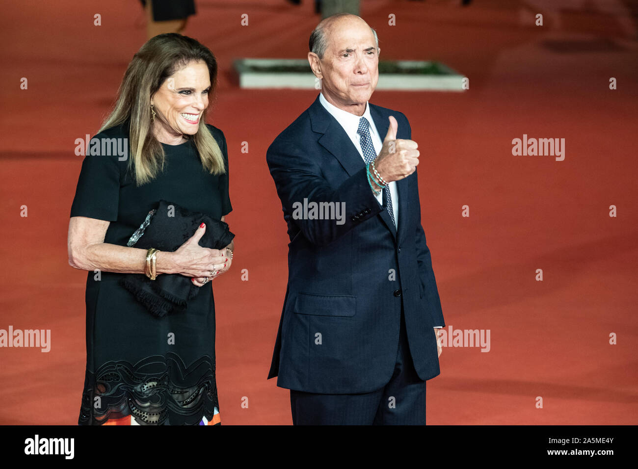 """US ambassador to Italy, Lewis M. Eisenberg gestures as he arrives for the screening of the film """"The Irishman"""" during the 14th Rome Film Festival. Stock Photo"""